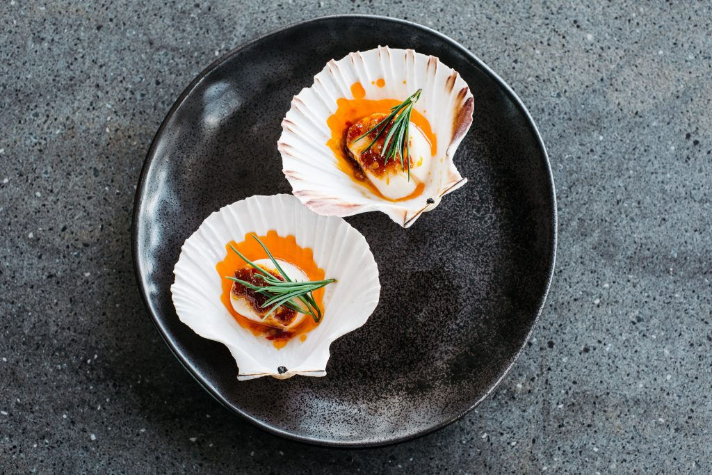 Steamed half shell scallops with garlic, chilli and seablite at Chi by Lotus